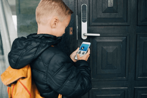 boy accessing door secured with system