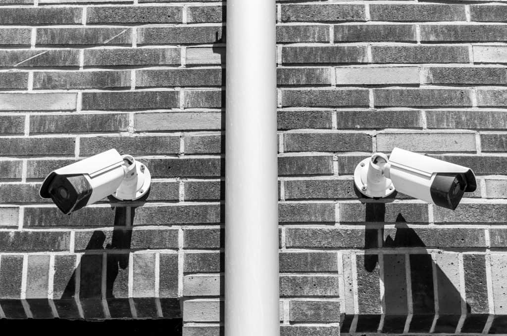residential building with two cameras